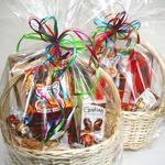Gift Baskets with any products we carry for any budget.  Try our sweet basket filled with cookies, chocolates and candy -- it's our most popular!
